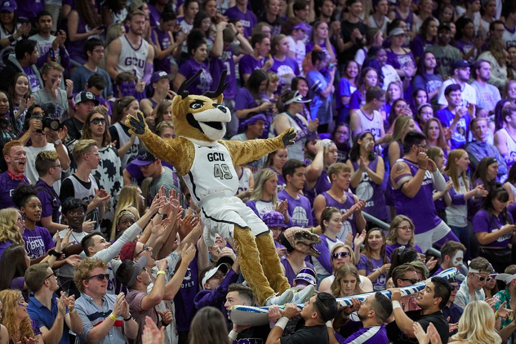 GCU Mascot Thunder in the students section crowd surfing at the GCU Arena
