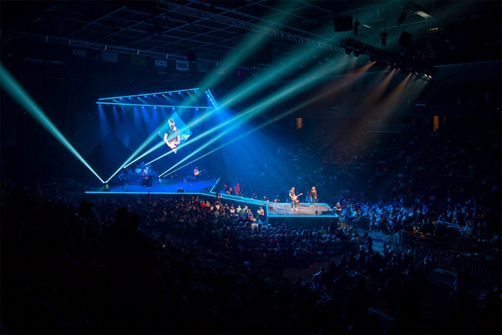 A concert with a blue light show at the GCU Arena