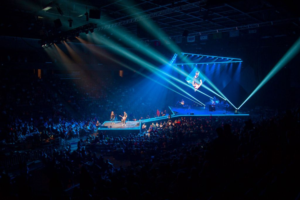 Band performing on stage in GCU Arena