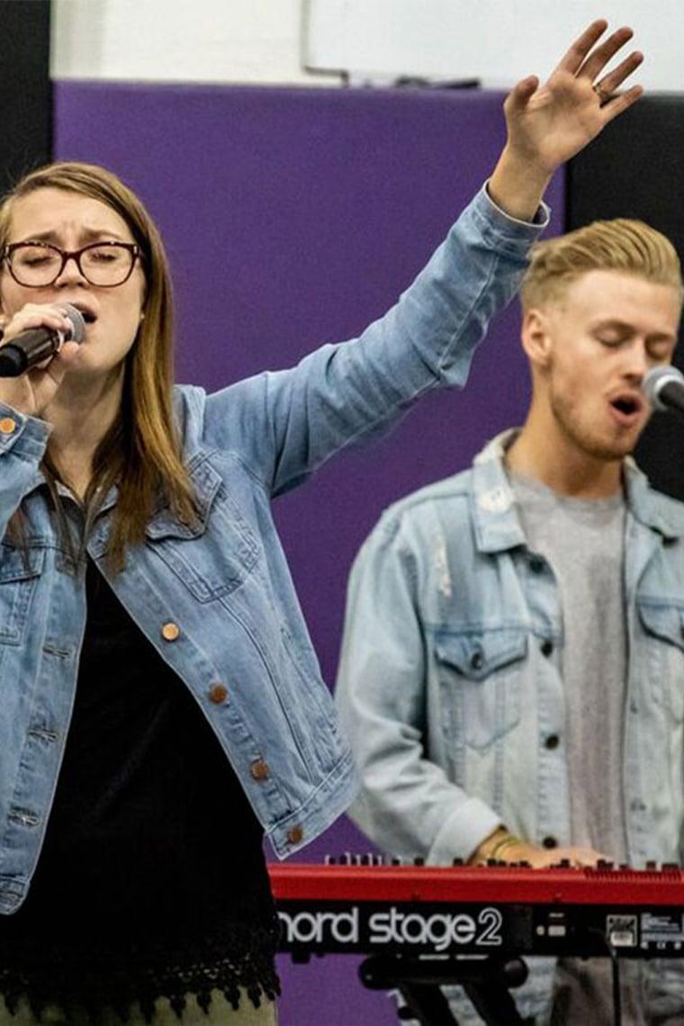 Two GCU Students singing at Canyon Worship