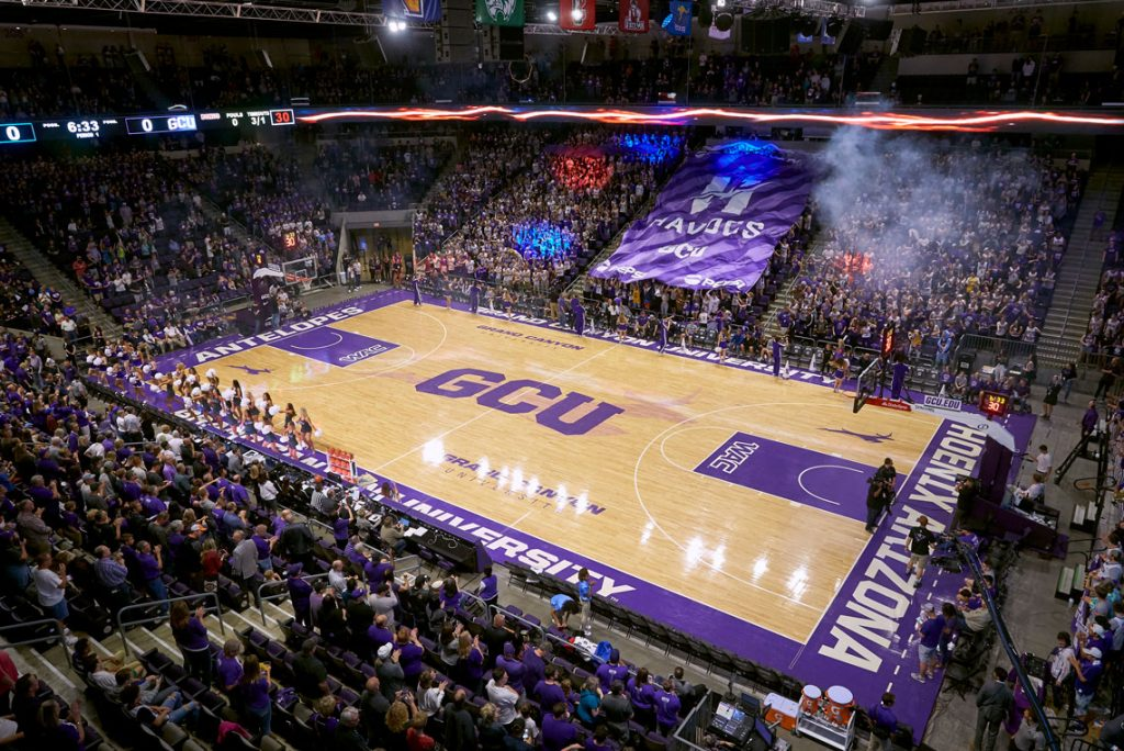 GCU Arena basketball court with fans celebrating in the stands
