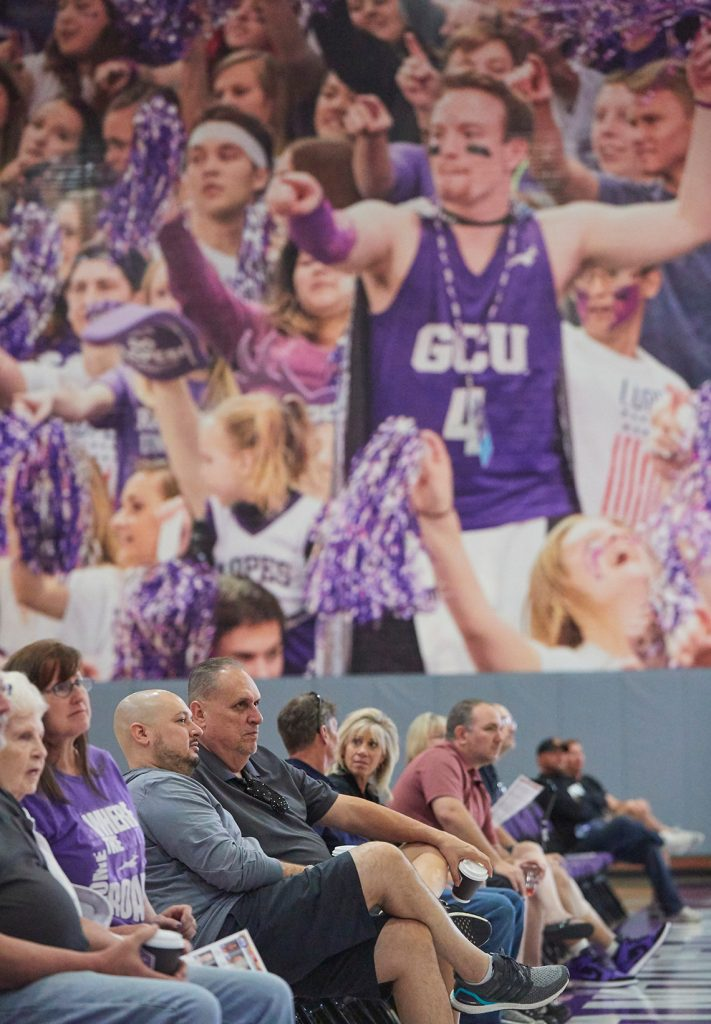 People watching a game in the GCU basketball practice facility
