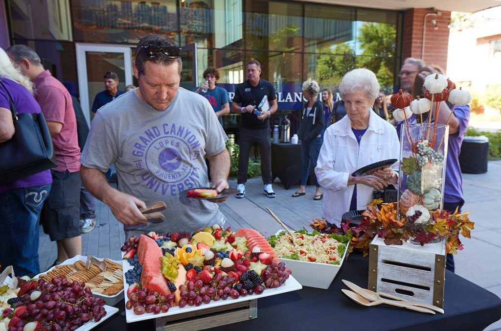 Lopes Club members in line for food