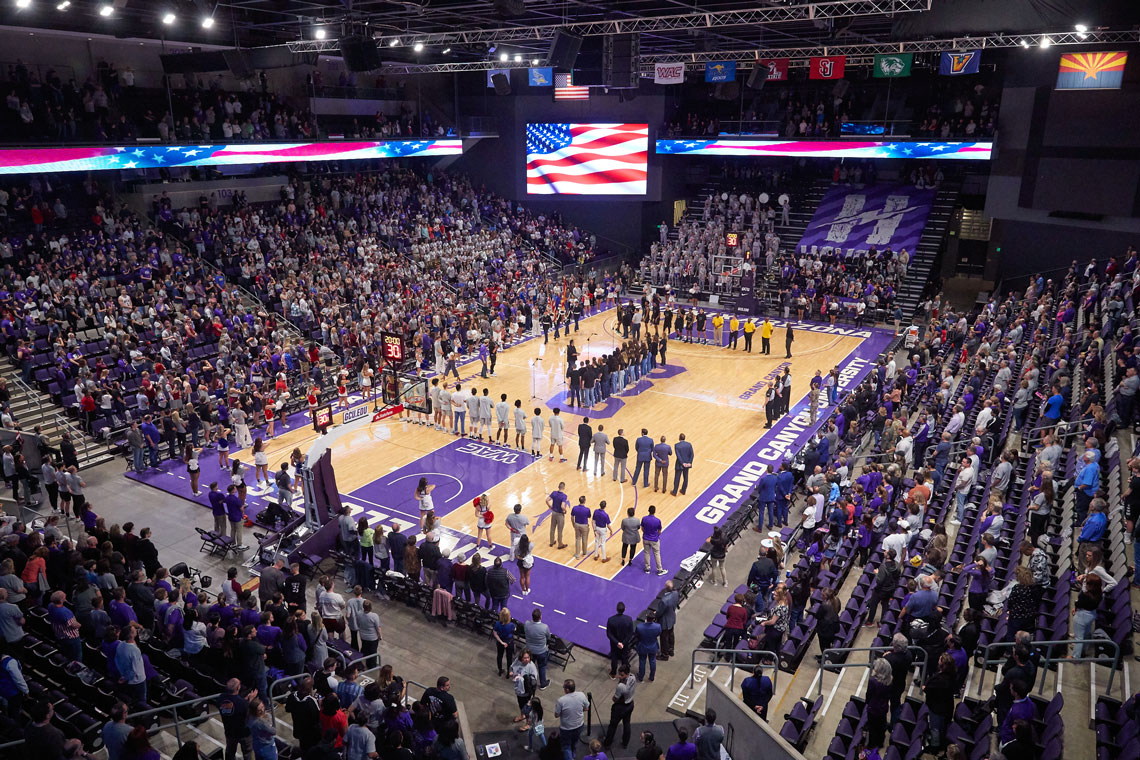 GCU Men's Basketball game standing at attention for the Star Spangle Banner